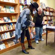 Poet Karla K. Morton shows off her boots.