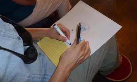 A participant draws during Dumitru's workshop.