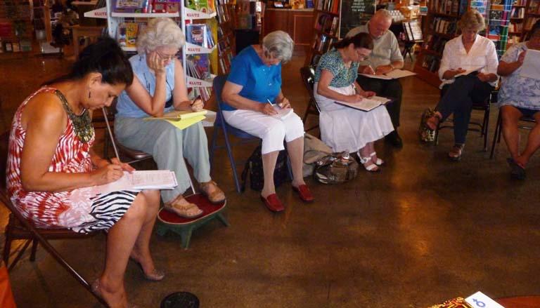 Participants write image-based poems during Dumitru's workshop.