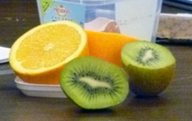 an orange and a kiwi fruit, sliced open